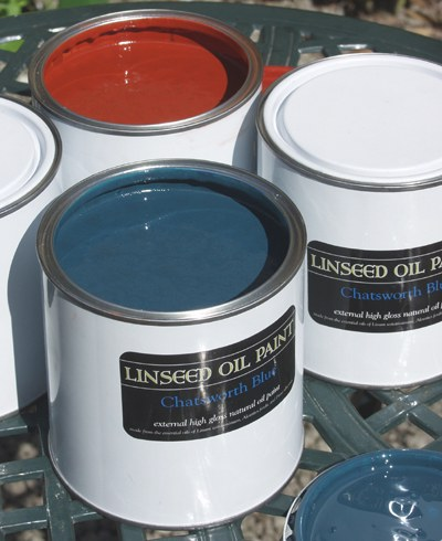 photograph of tins of linseed oil paint